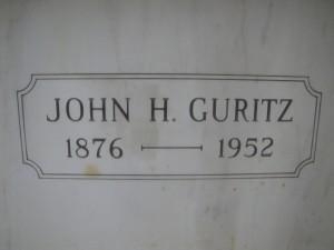 JOHN H. GURITZ