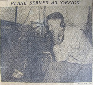 Loren on telephone inside Cessna 1948