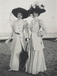 Two_Women_on_Beach_wearing_large_black_hats_1900s